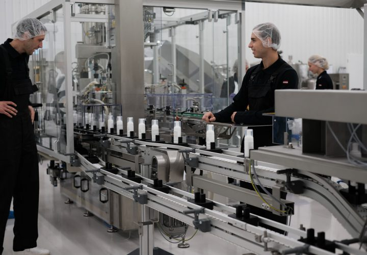 Cosmetic products on production line in factory